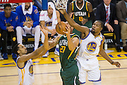 Golden State Warriors guard Shaun Livingston (34) fouls Utah Jazz center Rudy Gobert (27), as Golden State Warriors forward Kevin Durant (35) attempts to block the shot, during a lay up attempt at Oracle Arena in Oakland, Calif., on December 20, 2016. (Stan Olszewski/Special to S.F. Examiner)