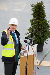 © Licensed to London News Pictures. 15/3/2016. Alrewas, Staffordshire, UK. National Memorial Arboretum Topping Out.<br /> Photo credit : Dave Warren/LNP.<br /> Pictured JOHN COOPER, (Chair of the Project Board) and the Yew tree.<br /> <br /> The highest stone that will clad the roof of the new, £15.7m Remembrance Centre at the National Memorial Arboretum (NMA) in Staffordshire was put in place earlier today.<br /> The ceremony will mark the half way point in the creation of the centre, which will educate, inform and inspire up to 500,000 visitors per year, and is on schedule for completion by the autumn.<br /> <br /> The facilities are being provided thanks to a major fundraising campaign, launched by HRH The Duke of Cambridge, along with generous donations from both Staffordshire County Council and the Heritage Lottery Fund.<br /> £11m has been raised so far and organisers continue to appeal for help in raising the remaining £4.7m required for the project. The Arboretum will remain open throughout the construction period.