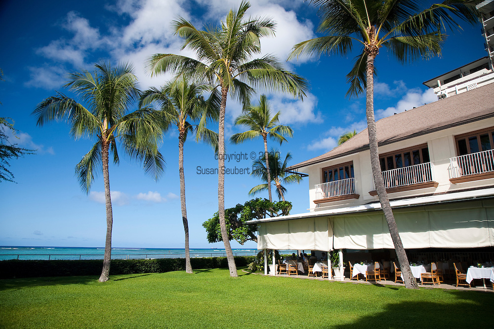 The Halekulani Hotel, the Hawaiian name meaning House Befitting Heaven, located on Waikiki beach in Honolulu, Hawaii offers stunning views of Diamond Head in a historic, secluded and exclusive setting. The exterior of La Mer and The Orchid restaurants.