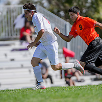 Grants Pirate Tyler Hickman (12) sprints past Gallup Bengal Rodolfo Rebollo (9) on his way to a goal Thursday at Grants High School.