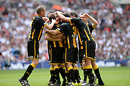 Morpeth Town players celebrate at the end of the FA Vase match between Hereford FC  and Morpeth Town at Wembley Stadium, London, England on 22 May 2016. Photo by Dennis Goodwin.