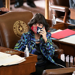 Austin, TX USA March 31, 2021:  State Rep. Valoree Swanson, R-Spring, on the floor of the Texas House of Representatives during routine bill readings at the 87th Texas legislative session. Emergency bills include power company regulation, border security and the coronavirus response.
