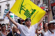 young man carrying protest flag at the Anti-war march, 22nd July, 2006, london, UK