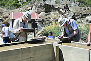 New Zealand, South Island, Kawarau Gorge Gold Mining Centre. Tourist pan for gold