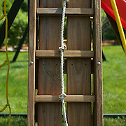 Knotted rope against a playset ladder
