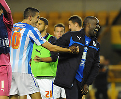 Huddersfield Town Manager, Chris Powell jokes with goal scorer Conor Coady - Photo mandatory by-line: Dougie Allward/JMP - Mobile: 07966 386802 - 01/10/2014 - SPORT - Football - Wolverhampton - Molineux Stadium - Wolverhampton Wonderers v Huddersfield Town - Sky Bet Championship