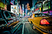 On my knees between a cab and a limousine inTimes Square, Manhattan, New York, 2010.