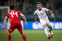 Guillermo Varela of Uruguay national football team dribbles against Wales national football team in their final match during the 2018 Gree China Cup International Football Championship in Nanning city, south China's Guangxi Zhuang Autonomous Region, 26 March 2018.