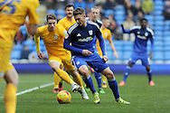 Cardiff City's Anthony Pilkington © takes on the Preston defence. Skybet football league championship match, Cardiff city v Preston NE at the Cardiff city stadium in Cardiff, South Wales on Saturday 27th Feb 2016.<br /> pic by Carl Robertson, Andrew Orchard sports photography.
