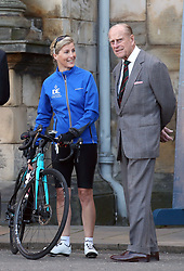 File photo dated 19/09/16 of the Countess of Wessex speaking with the Duke of Edinburgh before leaving the Palace of Holyroodhouse in Edinburgh at the start of a 450 mile cycle ride to Buckingham Palace in London, for her 'DofE Diamond Challenge' to mark the 60th anniversary of The Duke of Edinburgh's Award Scheme. The Duke of Edinburgh's Award is likely to be judged Prince Philip's greatest legacy. Issue date: Friday April 4, 2021.