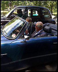 Image ©Licensed to i-Images Picture Agency. 27/06/2014. London, United Kingdom. Prince Charles in the passenger seat of his open top Aston Martin, sits in traffic as he drives through central London. Picture by  i-Images / i-Images
