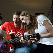 Aarhus, Denmark, June 10th 2010. Thomas  and Gitte singing for Laura. Thomas is at home studying engineering and helping his wife Gitte to take care of the little Laura, 8 months old. Gitte, a social educator, took 1 year of maternity leave.