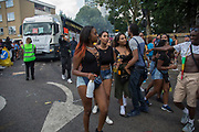 Monday on 28th August 2016 at the 50th Notting Hill Carnival in West London. A celebration of West Indian / Caribbean culture and Europes largest street party, festival and parade. Revellers come in their hundreds of thousands to have fun, dance, drink and let go in the brilliant atmosphere. It is led by members of the West Indian / Caribbean community, particularly the Trinidadian and Tobagonian British population, many of whom have lived in the area since the 1950s. The carnival has attracted up to 2 million people in the past and centres around a parade of floats, dancers and sound systems.