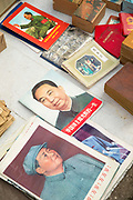 View from above of lots of old communist magazines for sale, Old Street, Tunxi district, Huangshan City, Anhui Province, China