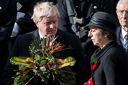 © Licensed to London News Pictures. 12/11/2017. London, UK.  Secretary of State for Foreign and Commonwealth Affairs BORIS JOHNSON and British Prime Minister THERESA MAY attend a Remembrance Day Ceremony at the Cenotaph war memorial in London, United Kingdom, on November 13, 2016 . Thousands of people honour the war dead by gathering at the iconic memorial to lay wreaths and observe two minutes silence. Photo credit: Ray Tang/LNP