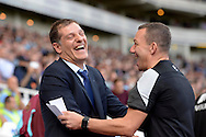 West Ham United manager Slaven Bilic shares a  joke with the Fourth Official Kevin Friend . Barclays Premier League, West Ham Utd v Norwich city at The Boleyn Ground, Upton Park in London on Saturday 26th September 2015.<br /> pic by John Patrick Fletcher, Andrew Orchard sports photography.
