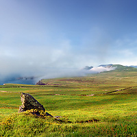 Misty Sea fog arising at the Cliffs of Valentia Island, Ring of Kerry, Ireland / vl082