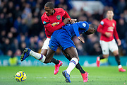 Odion Ighalo of Manchester United and Kurt Zouma of Chelsea challenge for the ball during the English Premier League match between Chelsea and Manchester United at Stamford Bridge, Monday, Feb. 17, 2020, in London, United Kingdom. Manchester United defeated Chelsea 2-0.(Salvio Calabrese/Image of Sport)