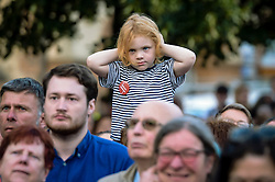 A youngster holds their ears as Labour leader Jeremy Corbyn takes part in a Labour leadership hustings at College Green, Bristol.