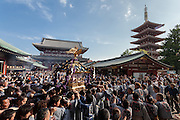 Mikoshi as they are carried in to Senso-ji Temple  during the Sanja matsuri. Asakusa, Tokyo, Japan. Sunday May 15th 2016 The Sanja matsuri is one of the biggest festivals in Japan. Taking place over the 3 days of the second weekend of May (May 13th to 15th) it features many mikoshi, or portable shrines, that are carried around by local groups to bring blessings and prosperity to their neighbourhoods