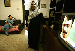 Alyaa Abdul Hassan Abbood, 23, a translator, is seen in her home in Baghdad, Iraq, Sept. 27, 2003. Abbood works with the U.S. military to mediate as Iraqi civilians come in to receive monetary compensation for damages done by American troops in Baghdad.