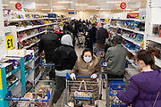 Heg0094691 . Daily Telegraph <br /> <br /> DT News<br /> <br /> Crowded early morning supermarket as media reports suggest that London could be in lockdown by the weekend creating further panic buying . <br /> <br /> London 19 March 2020
