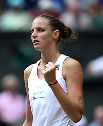 Karolina Pliskova celebrates winning the first set against Victoria Azarenka on day three of the Wimbledon Championships at the All England Lawn Tennis and Croquet Club, Wimbledon. PRESS ASSOCIATION Photo. Picture date: Wednesday July 4, 2018. See PA story TENNIS Wimbledon. Photo credit should read: Jonathan Brady/PA Wire. RESTRICTIONS: Editorial use only. No commercial use without prior written consent of the AELTC. Still image use only - no moving images to emulate broadcast. No superimposing or removal of sponsor/ad logos. Call +44 (0)1158 447447 for further information.