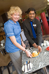 Sheffield MP Meg Munn gave her support to British Tourism Week by getting a taste of what it would be like working at The Park Inn Hotel on Blonk Street Sheffield, where Breakfast Supervisor Sia Swaroop she was taught how to prepare tables in the Picasso restaurant for the guests breakfasts..19th March 2010