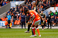 Wimbledon forward James Hanson (18) with a header  during the EFL Sky Bet League 1 match between Blackpool and AFC Wimbledon at Bloomfield Road, Blackpool, England on 20 October 2018.