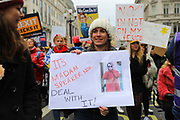 Women with banners at the Bread and Roses Womens March on January 19, 2019 in London, England.  The event was dubbed the Bread and Roses March based on the strikes of the same name by textile workers in Massachusetts in 1912 and Bread and Roses is the title of a poem by American poet James Oppenheim about the strikes.