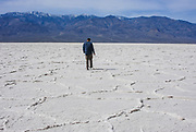 Man Walking Across Death Valley Salt Flats