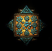 Reliquary locket (gau), 1800s, Tibet, tin, turquoise stone.  The locket once contained written prayers which had a protective function.