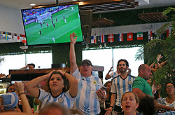 June 21, 2018 - Miami Beach, FL, USA - Fans of Argentina's national soccer team react after a play as they watch a television broadcast of the Russia 2018 World Cup match between Argentina and Croatia at Manolo on Thursday, June 21, 2018 in Miami Beach, Fla. Croatia won 3-0. (Credit Image: © David Santiago/TNS via ZUMA Wire)