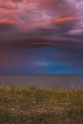 Spectacular sunrise with colorful rain clouds over dunes and baltic sea, near Ventspils, Kurzeme, Latvia Ⓒ Davis Ulands   davisulands.com