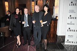 Left to right, ISABEL FONSECA, MARTIN AMIS, DAVID GILMOUR and POLLY SAMSON  at the Liberatum Dinner hosted by Ella Krasner and Pablo Ganguli in honour of Sir V S Naipaul at The Landau at The Langham, Portland Place, London on 23rd November 2010.