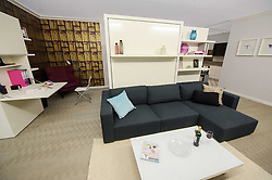 © Licensed to London News Pictures. 15/03/2013 London, UK.  A view of a re-fit of Dell Boy's famous Peckham flat living room at the Ideal Home Show 2013. The Trotters Only Fools and Horses residence has been given a modern makeover by Celebrity designer George Clarke. .Photo credit : Simon Jacobs/LNP