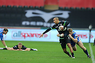 Eli Walker of the Ospreys is tackled by Jack Dixon of the Newport Gwent Dragons.  Guinness Pro12 rugby match, Ospreys v Newport Gwent Dragons at the Liberty Stadium in Swansea, South Wales on 29th October 2016.<br /> pic by Andrew Orchard, Andrew Orchard sports photography.