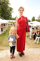 NATALIA VODIANOVA and her daughter NEVA PORTMAN at a luncheon hosted by Cartier for their sponsorship of the Style et Luxe part of the Goodwood Festival of Speed at Goodwood House, West Sussex on 4th July 2010.