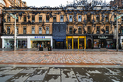 Glasgow, Scotland, UK. 21 November 2020. Views of Saturday afternoon in Glasgow city centre on first day of level 4 lockdown. Non essential shops and businesses have closed. And streets are very quiet. Pictured;  Buchanan Street shopping precinct is almost deserted with no shops open including Princes Square here .Iain Masterton/Alamy Live News