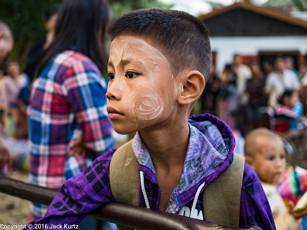 26 OCTOBER 2016 - NUPO TEMPORARY SHELTER, MAE CHAN, TAK, THAILAND: A Burmese child in the Nupo Temporary Shelter refugee camp waits to be repatriated to Myanmar. Sixtyfive Burmese refugees living in the Nupo Temporary Shelter refugee camp in Tak Province of Thailand were voluntarily repatriated to Myanmar. About 11,000 people live in the camp. The repatriation was the first large scale repatriation of Myanmar refugees living in Thailand. Government officials on both sides of the Thai / Myanmar border said the repatriation was made possible by recent democratic reforms in Myanmar. There are approximately 150,000 Burmese refugees living in camps along the Thai / Myanmar border. The Thai government has expressed interest several times in the last two years in starting the process of repatriating the refugees.     PHOTO BY JACK KURTZ
