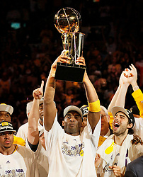 File photo of Kobe Bryant hoists the Larry O'Brien trophy as the Los Angeles Lakers celebrate their 83-79 win over the Boston Celtics in Game 7 of the NBA Finals at Staples Center in Los Angeles, California, on Thursday, June 17, 2010. (Robert Gauthier/Los Angeles Times/TNS/ABACAPRESS.COM)