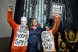 © Licensed to London News Pictures. 22/02/2020. LONDON, UK.  People in costumes pose outside Australia House in Aldwych ahead of a march to Parliament Square in support of Wikileaks founder Julian Assange.  The full extradition trial of Mr Assange begins in London on 24 February.  Photo credit: Stephen Chung/LNP