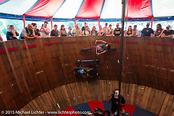 Sandra Donmoyer and Ian of the California Hell Riders ride the pursuit race on the Wall Of Death at the Iron Horse Saloon during the 2015 Biketoberfest Rally. Ormond Beach, FL, USA. October 17, 2015.  Photography ©2015 Michael Lichter.