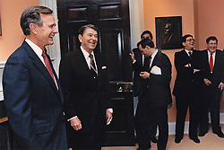 United States President Ronald Reagan, center left, and US President Elect George H.W. Bush say thank you to Senior Staff Members on January 19, 1989, the day before Bush will be inaugurated as the 41st President of the United States, including Chief of Staff Ken Duberstein, Second from right, and new Chief of Staff John Sununu, right, in the Roosevelt Room of the White House in Washington, DC. Mandatory Credit: Susan Biddle / White House via CNP /ABACAPRESS.COM