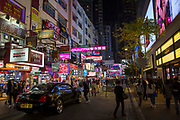 A black Bentley parked outside a Marathon Sports store on Lockhart Road, Causeway Bay, Hong Kong.