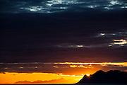 Sunset over mountains on the coast in Spitsbergen, Svalbard.