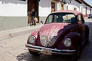 An old beetle fusca with peeling paint, Street scene, San Cristobal de las Casas, Chiapas, Mexico.