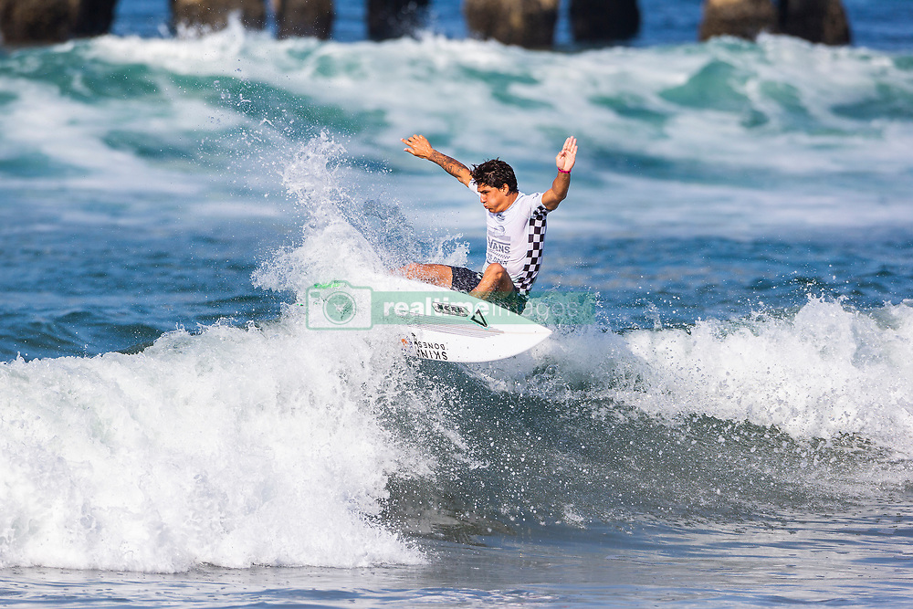 Tomas King (CRI) advances to Round 2 of the 2018 VANS US Open of Surfing after placing second in Heat 2 of Round 1 at Huntington Beach, California, USA.