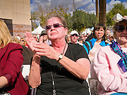 14 FEBRUARY 2012 - PHOENIX, AZ:    BRENDA ESSER, from Phoenix, cheers for Wayne Newton during Newton's free show in Phoenix Tuesday. Newton, who is originally from Phoenix, performed in front of the state capitol for about an hour Tuesday afternoon at the Arizona centennial. The state of Arizona marked 100 years of statehood with a free party in front of the capitol.    PHOTO BY JACK KURTZ
