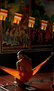 A Buddhist monk rests in a hammock in Siem Reap, Cambodia.